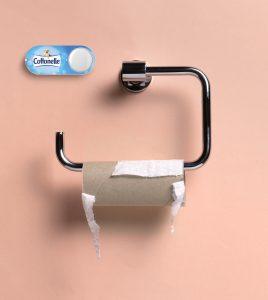 Dash Button neben leerer Toilettenpapierrolle